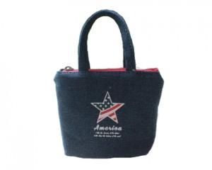 Blå taske med med hank og rød lynlås og en stjerne med det amerikanske flag Stars and Stripes