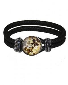 Armbånd i sort med sommerfugle smykke