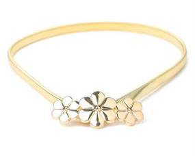 Metallisk guldbælte med med blomsterspænde
