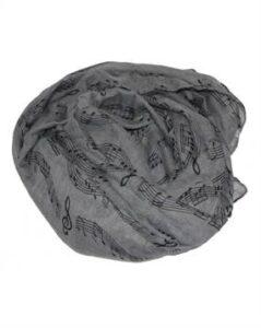 Musiktørklæde med noder. Gråt tørklæde med sorte noder.